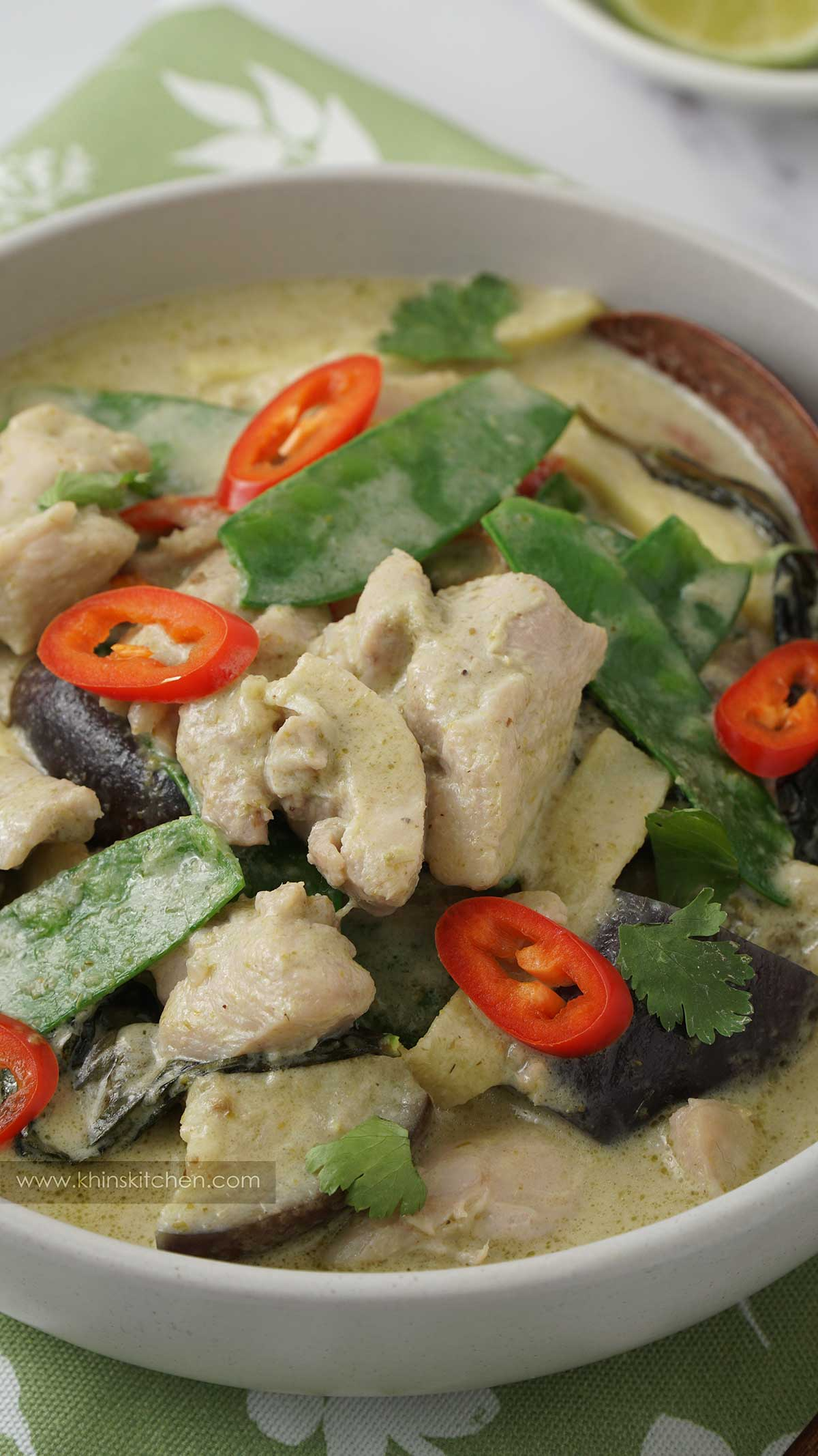 close up view of thai curry in a grey bowl.