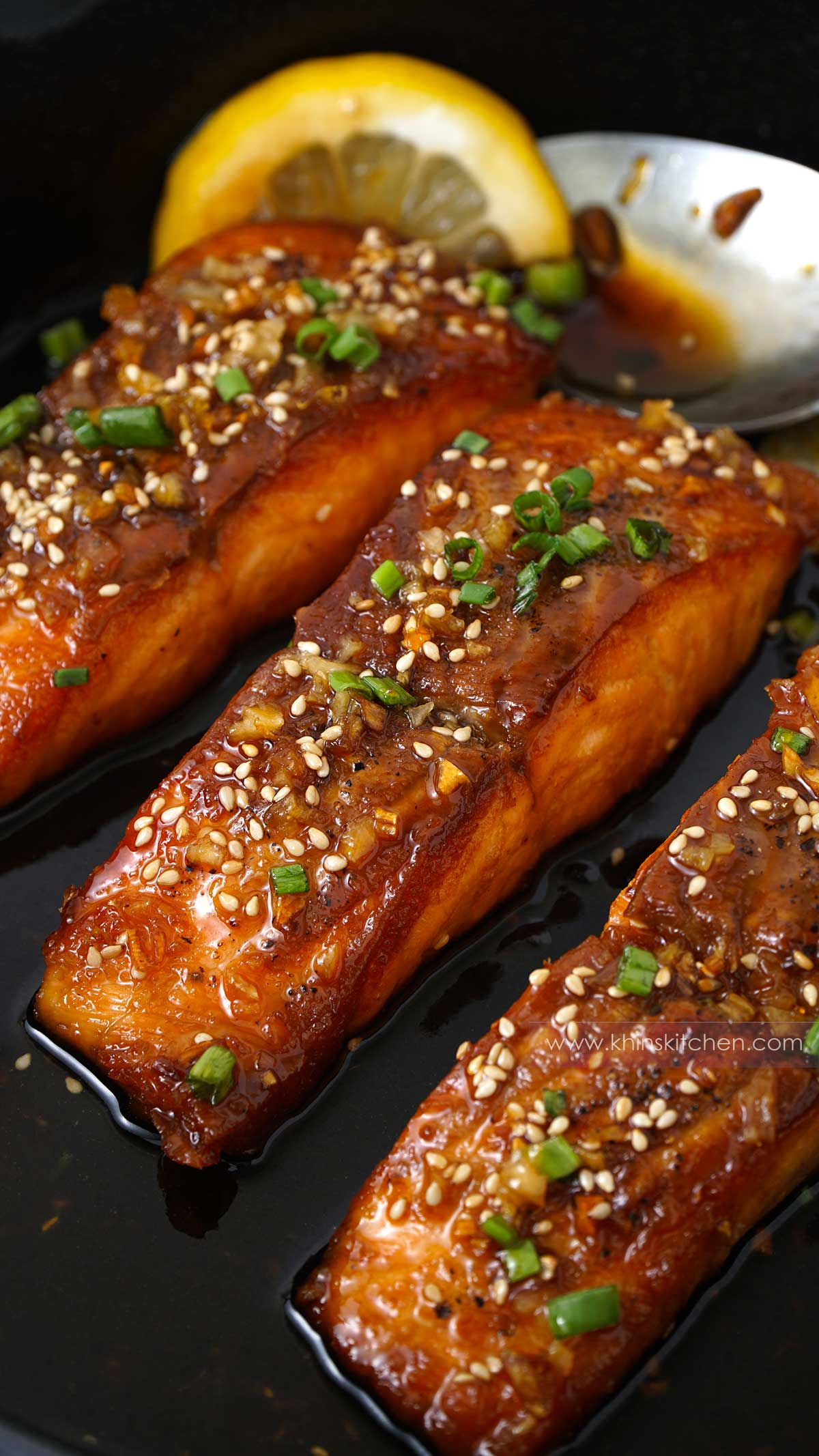 A skillet filled with honey garlic salmon.