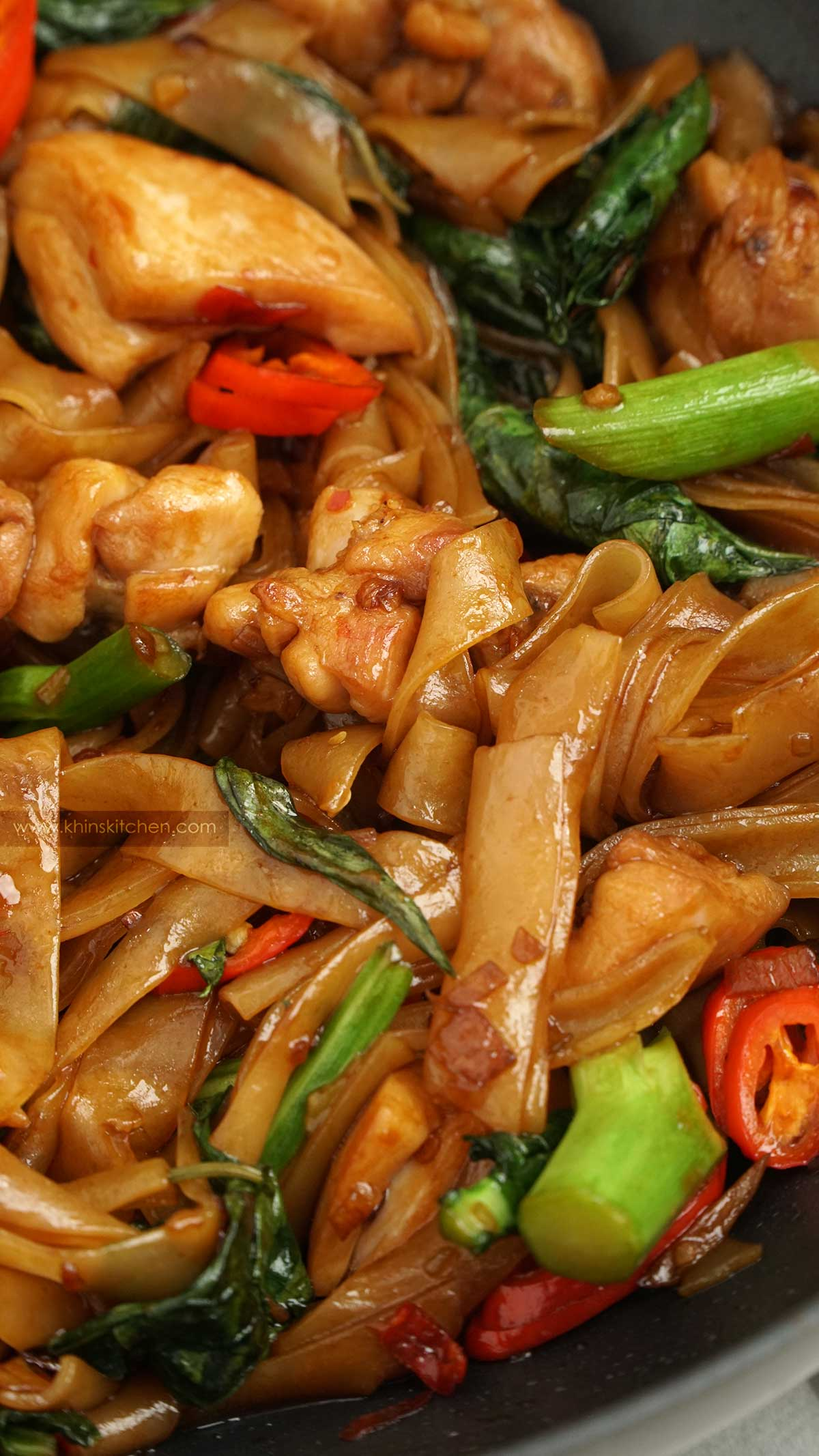 close up view of thai noodles stir fry in the pan.