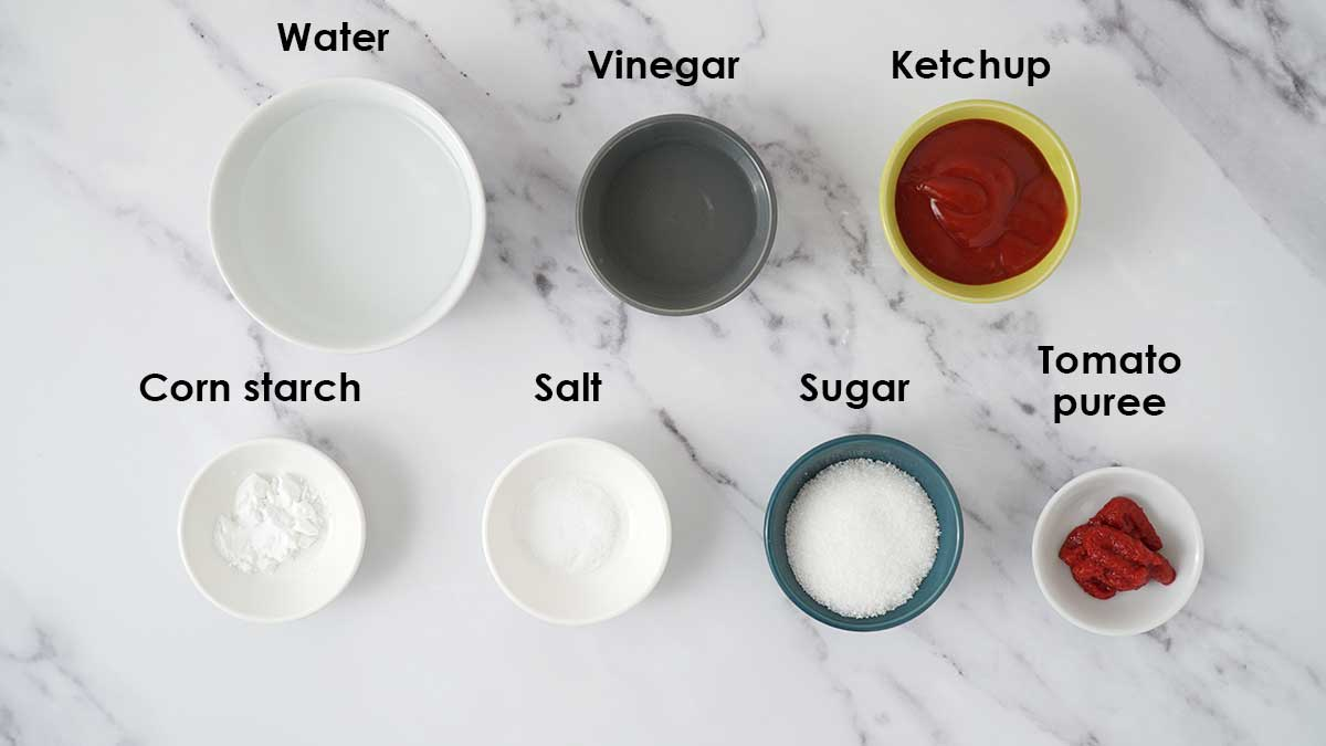 Ingredients for sweet and sour sauce on the white table.