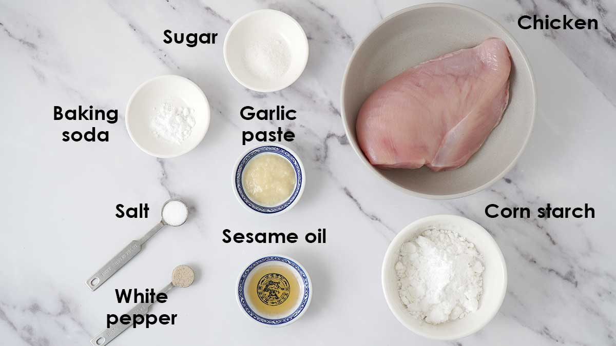 Labelled ingredients for chicken balls on the white table.