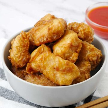 A grey bowl containing deep fried chicken balls.