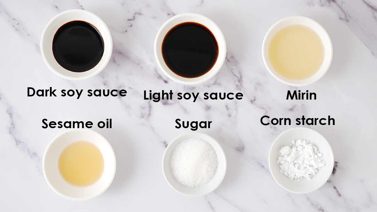 Labelled ingredients of stir fry udon sauce, displayed on the white table.