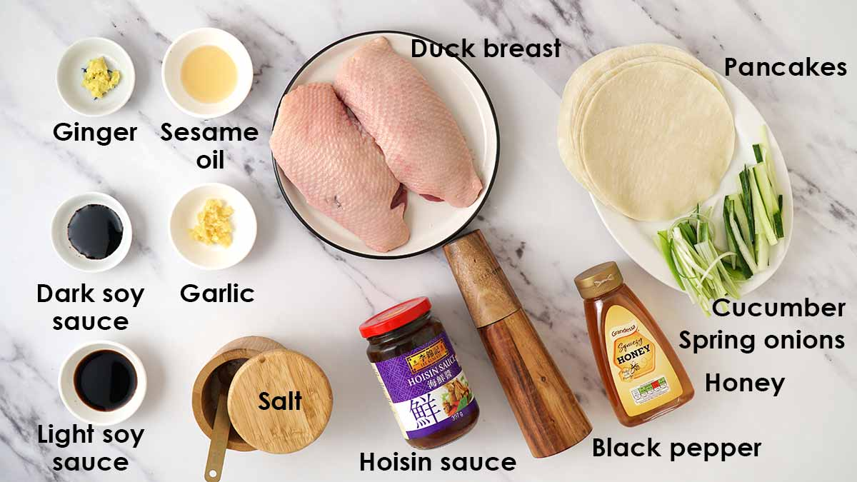 Labelled ingredients for hoisin duck laying on the white background table.